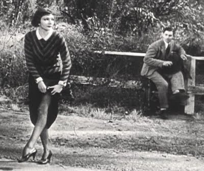 "Claudette Colbert shows her gams when she hitchhikes (with Clark Gable) in ""It Happened One Night."""