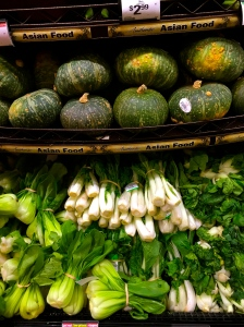 This store boasts a variety of bok choy and some kabocha squash.