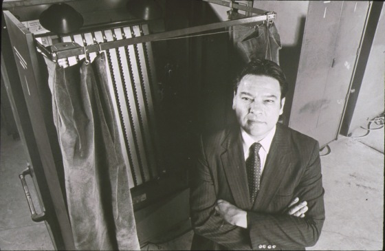 Photo 2 Willie Velasquez by a voting booth- Photo from southwest voter and education project collection